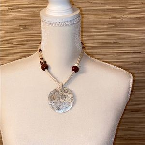 String, wooden beads and shell like disc necklace
